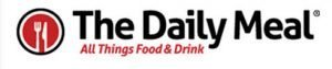 LOGO FOR THE DAILY MEAL. WHITE BACKGROUND WITH TEXT IN BLACK AND RED