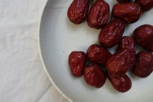 DRIED FRUIT DATES ON A WHITE PLATE - SINGLE INGREDIENT GROCERIES