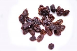 Raisins on white background.