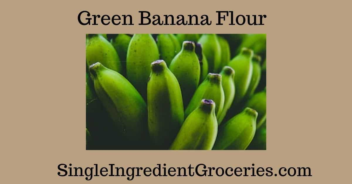 PHOTO OF GREEN BANANAS ON TAN BACKGROUND FOR BLOG POST ABOUT GREEN BANANA FLOUR FOR SINGLE INGREDIENT GROCERIES