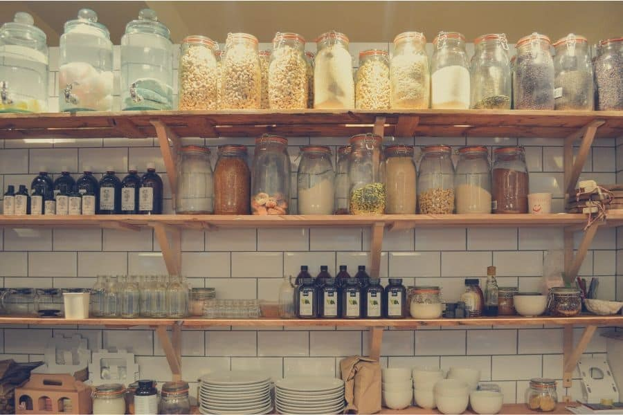 KITCHEN PANTRY WITH DISHES AND INGREDIENTS IN GLASS CONTAINERS