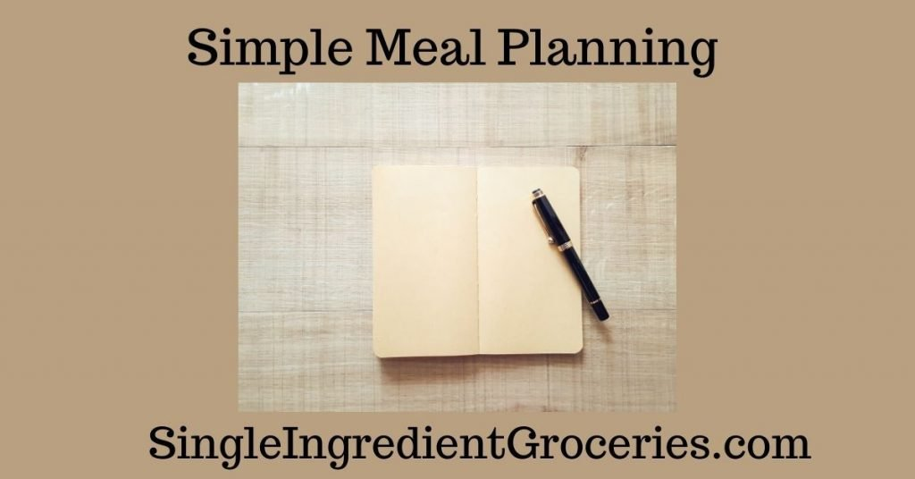 """BLOG POST IMAGE FOR SINGLE INGREDIENT GROCERIES TITLED """"SIMPLE MEAL PLANNING"""" WITH IMAGE OF BEIGE NOTEBOOK WITH BLACK PEN ON NEUTRAL BACKGROUND"""