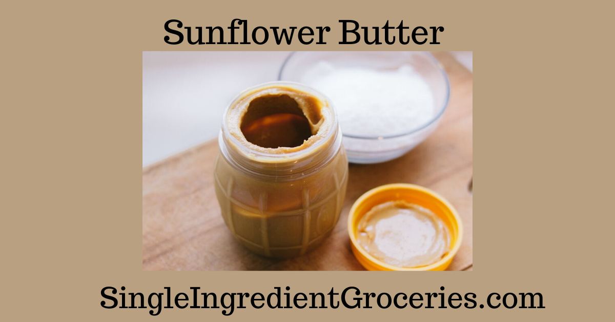 """BLOG POST IMAGE FOR SINGLE INGREDIENT GROCERIES WITH TITLE """"SUNFLOWER BUTTER"""" AND PHOTO OF OPENED JAR OF SUNFLOWER SEED BUTTER, YELLOW LID AND BOWL OF WHITE POWDER WHICH IS EITHER SUGAR OR SALT."""
