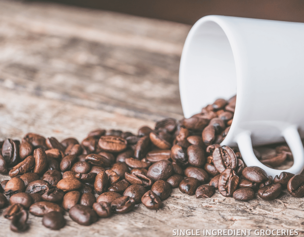 coffee beans in a mug on a table