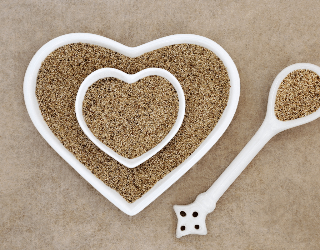 teff in a heart-shaped bowl and with spoon