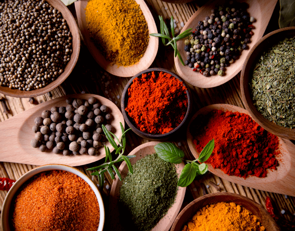 a variety of spices in spoons