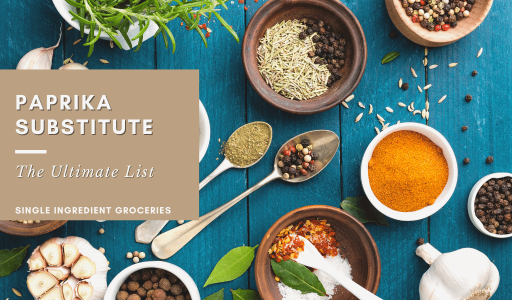 paprika substitute: the ultimate list blog banner with a variety of spices on a blue table.