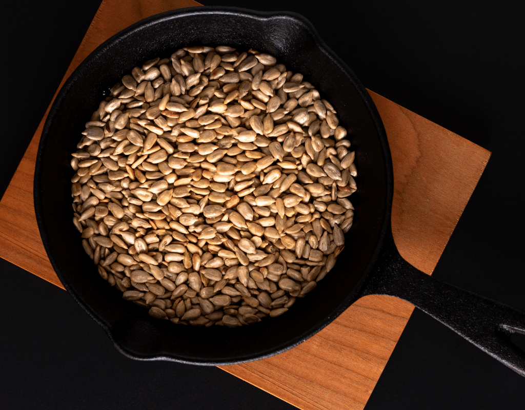 pan roasted sunflower seeds in a cast-iron pan