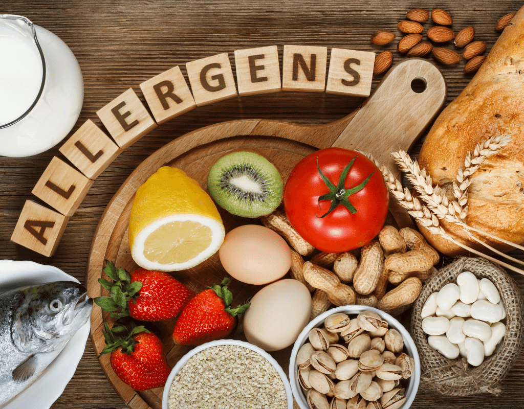 food allergy graphic with tomatoes, nuts, wheat, shellfish, beans strawberries