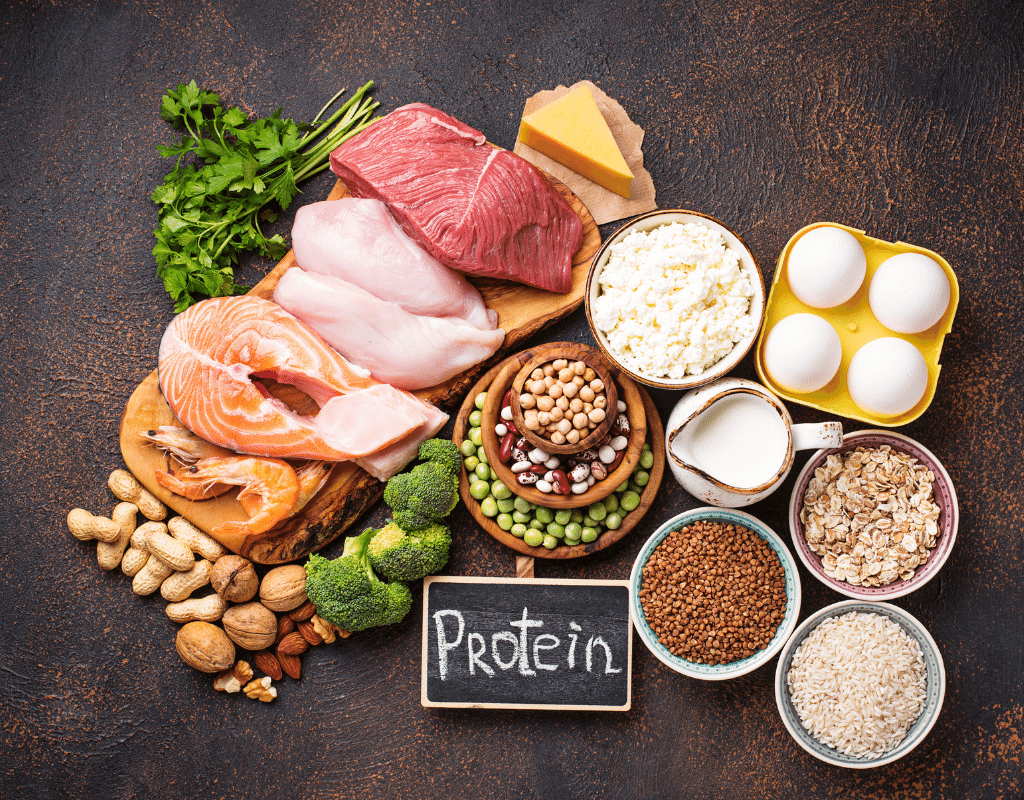 photo of protein rich single ingredient foods like salmon, chicken, eggs, rice, pats, nuts cheese