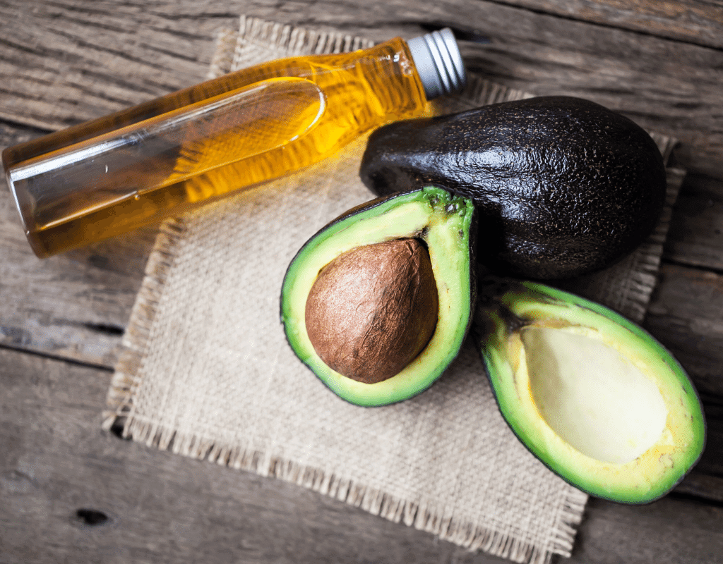 avocado  cut open with avocado oil  displayed