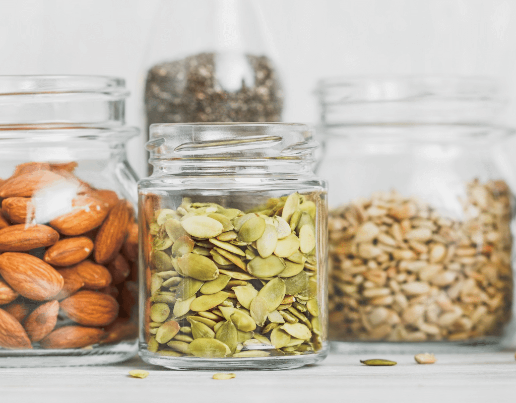 peanut alternatives in jars: almonds, pumpkin seeds, sunflower seeds