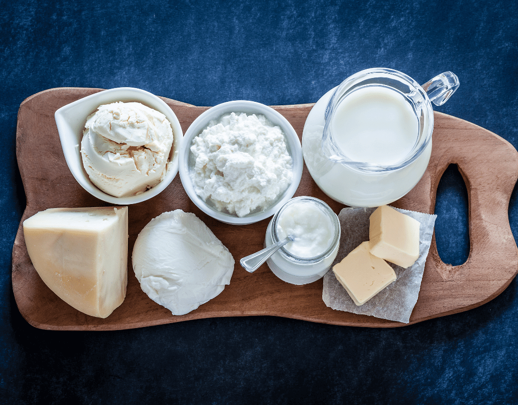 milk allergy, milk, yogurt, cheese, butter, and milk displayed on a wooden board, part of the top 8 food allergens