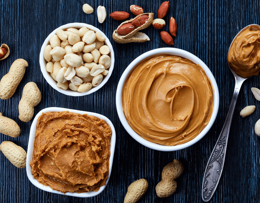 peanut butter and peanuts displayed on a dark background, image for top 8 food allergens