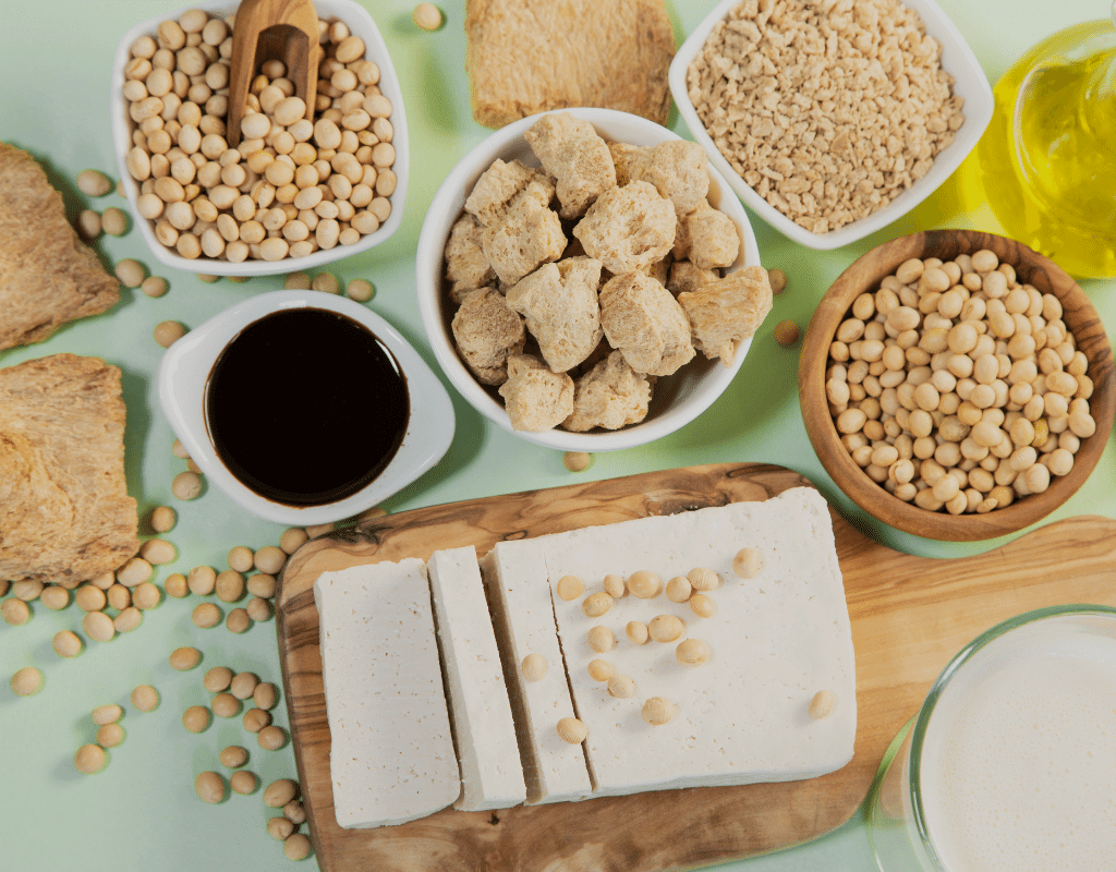 soy allergy products displayed: tofu, soy beans, soy sauce, and soy milk on a green background