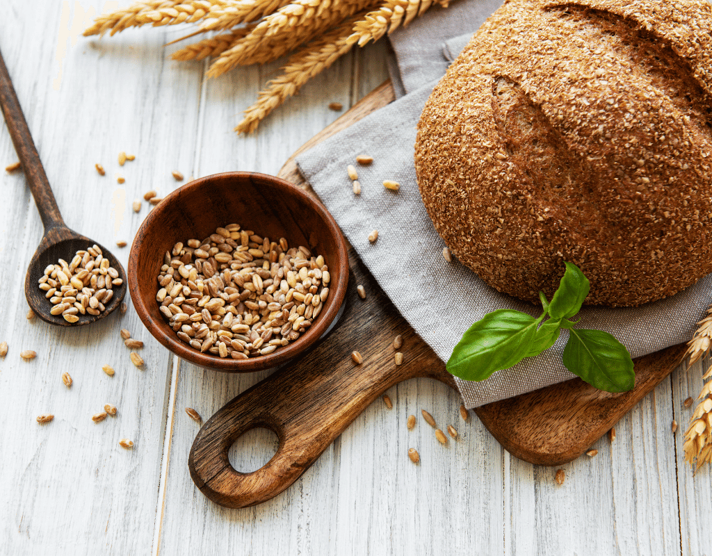 wheat bread, wheat displayed on a wooden board on a light background