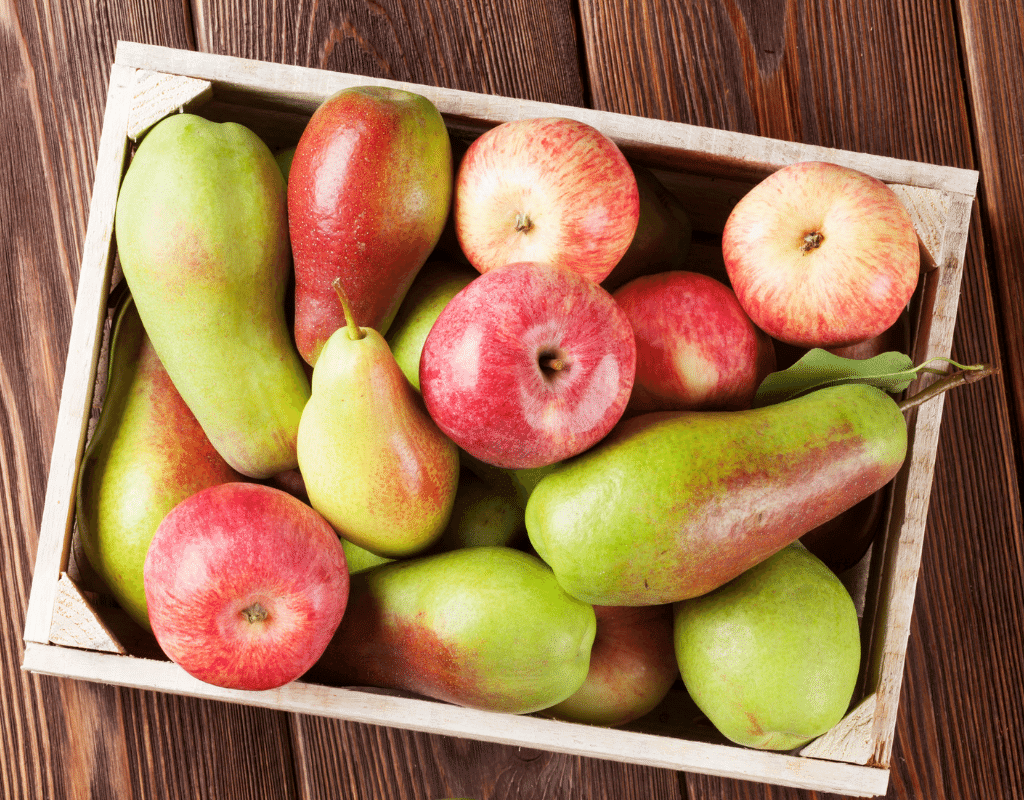 apples and pears in a wooden crate