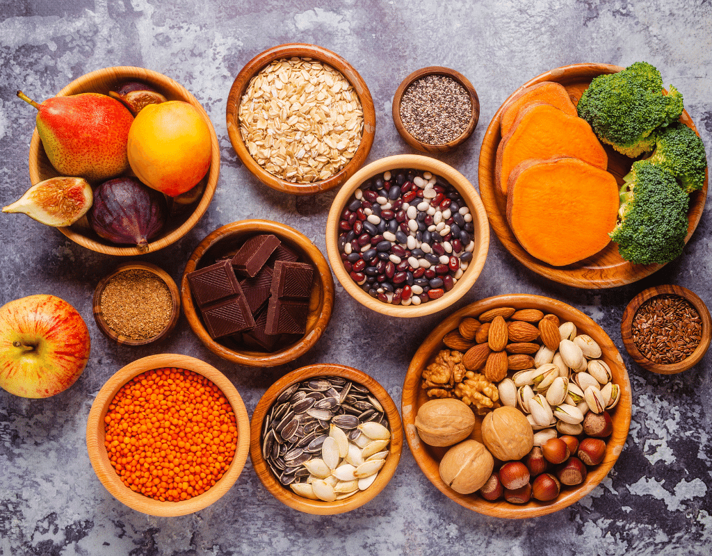 high fiber foods displayed on a gray background