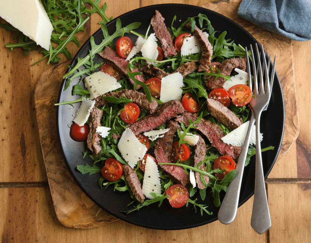 keto steak salad with tomatoes and cheese