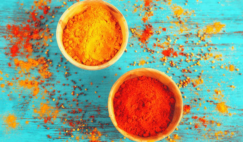 saffron powder and saffron threads displayed in jars