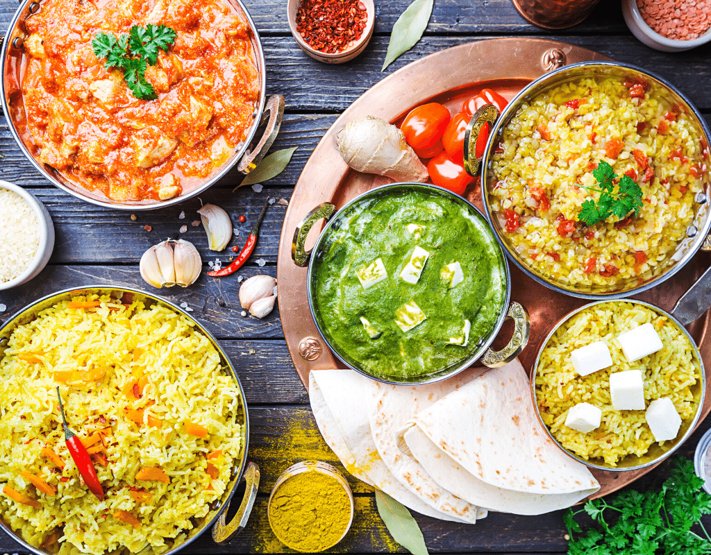 Indian food dishes displayed on a dark background