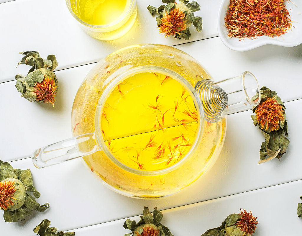 this saffron substitute is safflower oil and dried safflower displayed on a white background